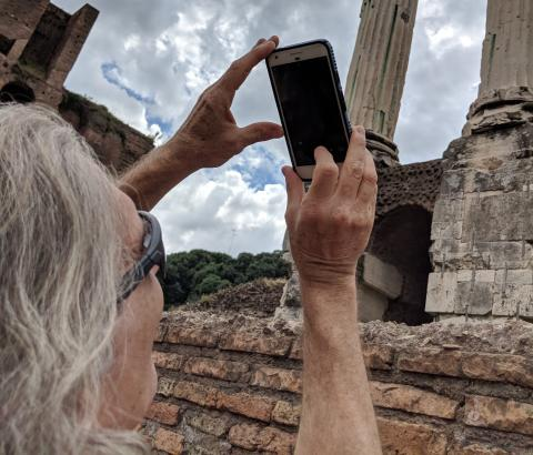 Man taking picture of ruins
